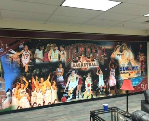 Wall graphics make the DU womens basketball locker room more fun.