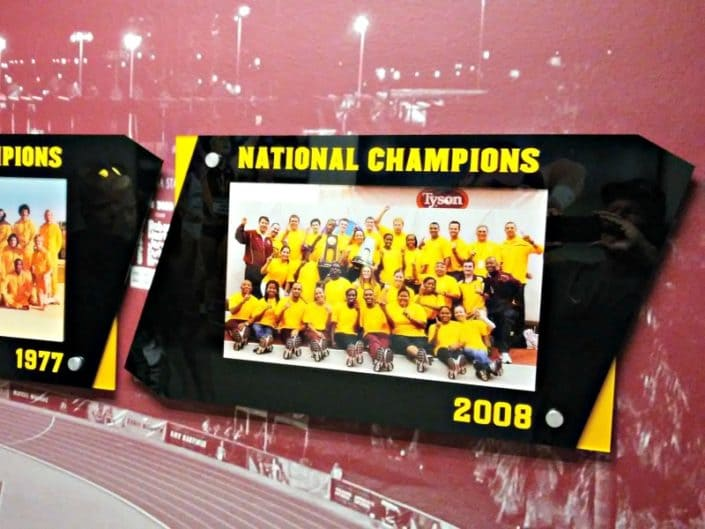 Acrylic signs for ASU Track showing off National Championships