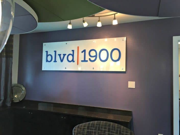 Acrylic logo sign spruces up the conference room