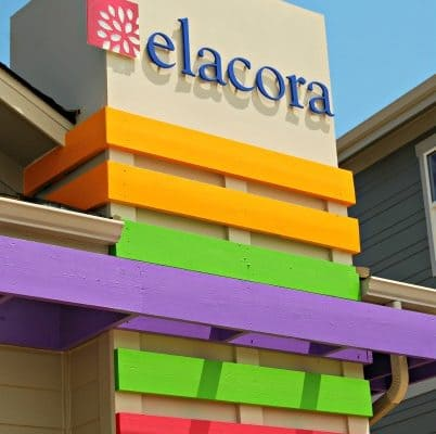 Colorful cool dimensional letters on the outside of Elacora Homes.