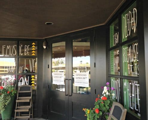 Window graphics set the tone of the meal at Flower Child Restaurant.