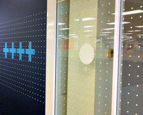 Intel ties the wall graphics right into the window with this 8os video game theme.