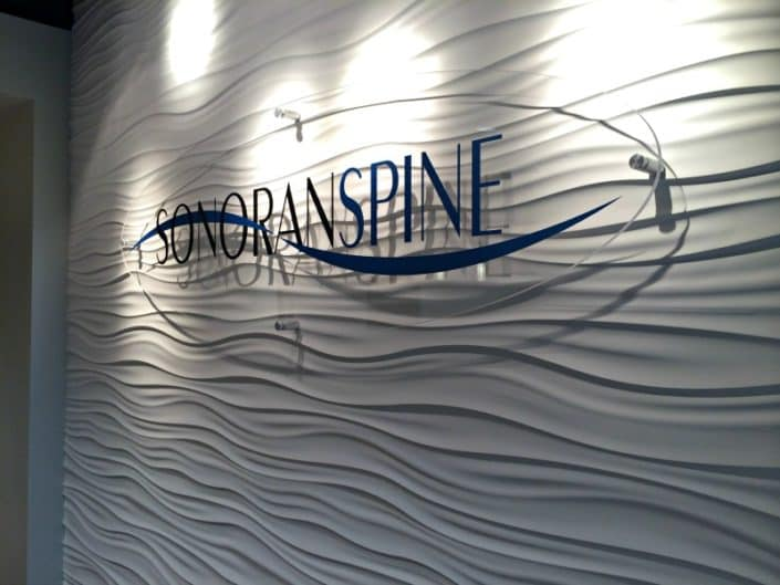 Ultra modern acrylic signage on a cool textured wall