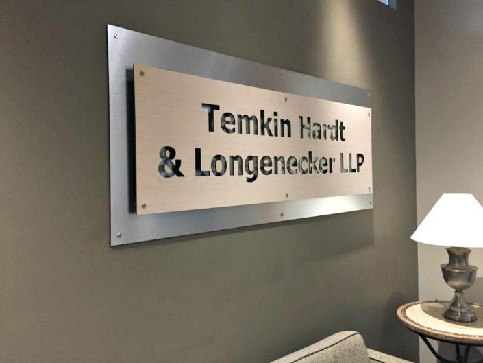 Sophisticated and sleek layered dimensional sign on brushed aluminum