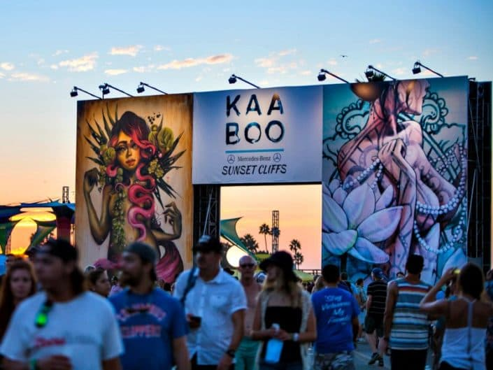The crowd leaving under the cool event graphics at kaaboo.