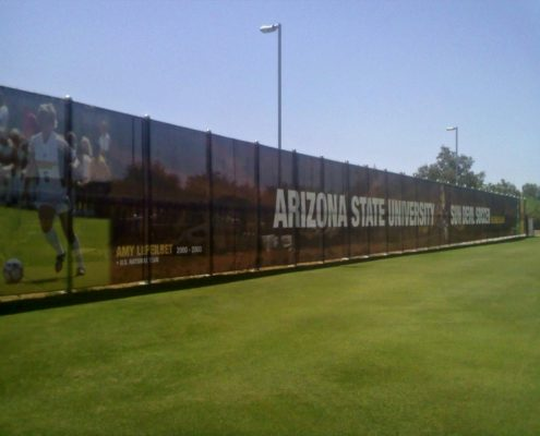 Fence mesh banner supporting the ASU Soccer Team