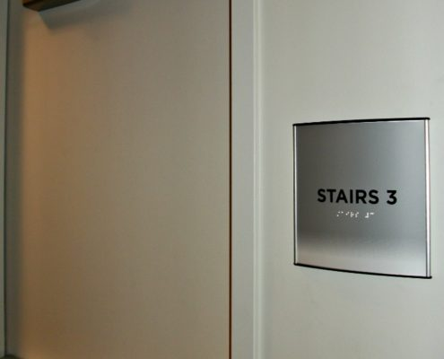 Braille is often required on dimensional letters i n offices.