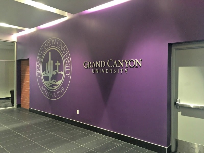 Grand Canyon Unversity showing off their seal with wall mural.