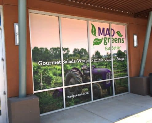 Delicious window graphics look as good as the food inside Mad Greens.