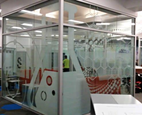 If you are going to work in a glass box, make it a cool glass box with window graphics.
