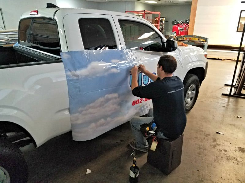 Installing car wraps is serious business and requires mad skills.